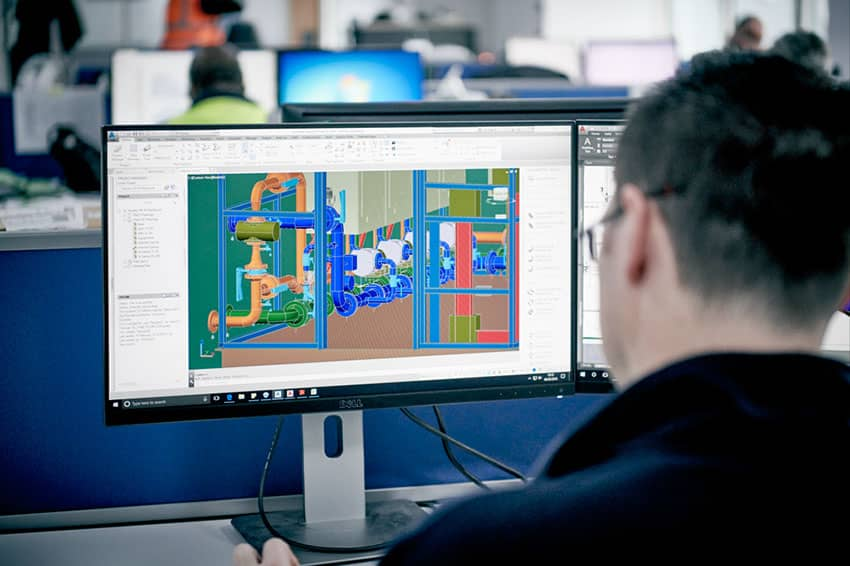 Man working with CAD drawing for an energy centre